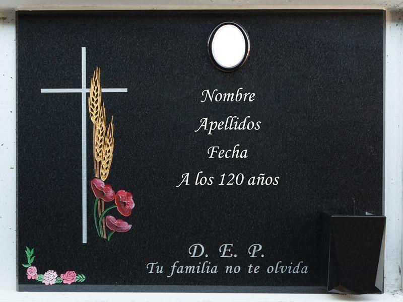 Lápida con cruz, espigas y amapolas grabadas